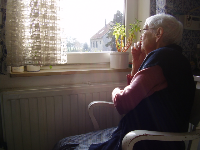 Neglected Elderly Woman Sitting