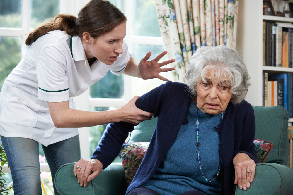 Elderly woman being mistreated by nursing home staff